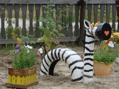 Children and Creativity. Zebra out of Tire-covers. Crafts for a Playground